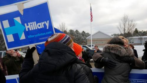 U.S. Democratic presidential candidate Hillary Clinton gets a hug from a supporter outside a polling place in Nashua, New Hampshire February 9, 2016, the day of New Hampshire's first-in-the-nation primary. REUTERS/Brian Snyder