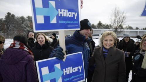 Democratic presidential candidate Hillary Clinton, right, campaigns with her daughter Chelsea Clinton, second from left, outside a polling place during the first-in-the-nation presidential primary, Tuesday, Feb. 9, 2016, in Nashua, N.H. (AP Photo/Matt Rourke)