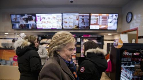 Democratic presidential candidate Hillary Clinton stops at Dunkin' Donuts with her daughter Chelsea Clinton, left, as she campaigns during the first-in-the-nation presidential primary, Tuesday, Feb. 9, 2016, in Nashua, N.H. (AP Photo/Matt Rourke)