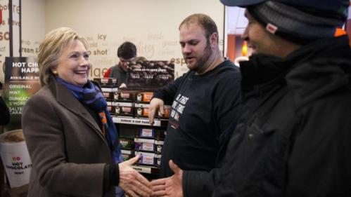Democratic presidential candidate Hillary Clinton meets with customers as she stops at Dunkin' Donuts during the first-in-the-nation presidential primary, Tuesday, Feb. 9, 2016, in Nashua, N.H. (AP Photo/Matt Rourke)