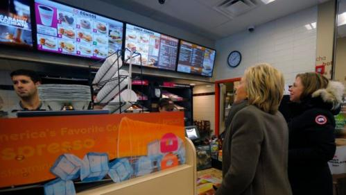 U.S. Democratic presidential candidate Hillary Clinton, and her daughter Chelsea (R), place an order at a Dunkin Donuts in Nashua, New Hampshire February 9, 2016, the day of New Hampshire's first-in-the-nation primary. REUTERS/Brian Snyder