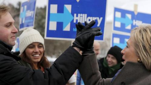 U.S. Democratic presidential candidate Hillary Clinton high-fives a supporter outside a polling place in Derry, New Hampshire February 9, 2016, the day of New Hampshire's first-in-the-nation primary. REUTERS/Brian Snyder