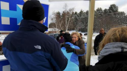 U.S. Democratic presidential candidate Hillary Clinton hugs a supporter outside a polling place in Nashua, New Hampshire February 9, 2016, the day of New Hampshire's first-in-the-nation primary. REUTERS/Brian Snyder