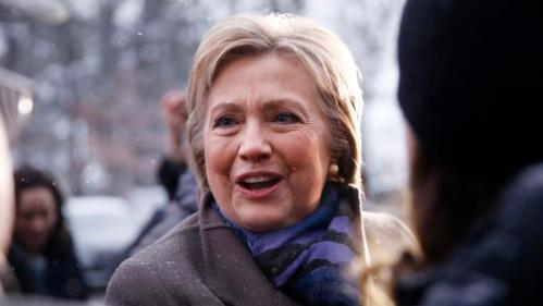 Democratic presidential candidate Hillary Clinton campaigns outside a polling place during the first-in-the-nation presidential primary, Tuesday, Feb. 9, 2016, in Manchester, N.H. (AP Photo/Matt Rourke)