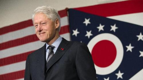 Former President Bill Clinton smiles as he campaigns for his wife, Democratic presidential candidate Hillary Clinton, Friday, Feb. 12, 2016, at the Clifton Cultural Arts Center in Cincinnati. (AP Photo/John Minchillo)