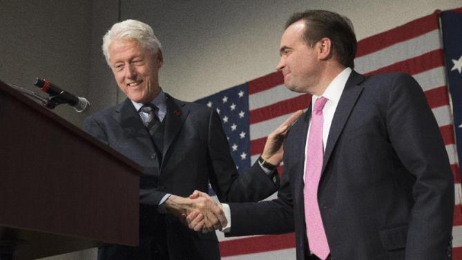 Former President Bill Clinton shakes hands with Cincinnati Mayor John Cranley as he campaigns for his wife, Democratic presidential candidate Hillary Clinton, Friday, Feb. 12, 2016, at the Clifton Cultural Arts Center in Cincinnati. (AP Photo/John Minchillo)