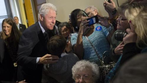 Former President Bill Clinton meets with attendees as he campaigns for his wife, Democratic presidential candidate Hillary Clinton, at the Clifton Cultural Arts Center, Friday, Feb. 12, 2016, in Cincinnati. (AP Photo/John Minchillo)
