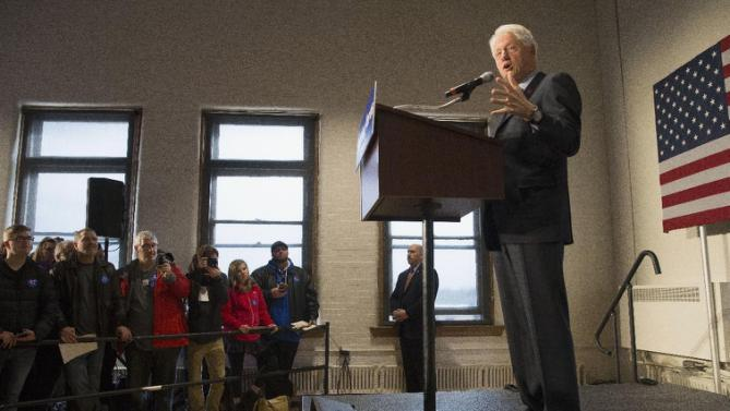 Former President Bill Clinton speaks as he campaigns for his wife, Democratic presidential candidate Hillary Clinton, Friday, Feb. 12, 2016, at the Clifton Cultural Arts Center in Cincinnati. (AP Photo/John Minchillo)