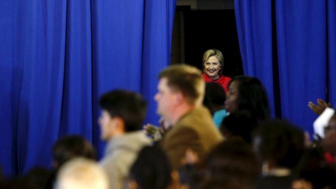 Democratic U.S. presidential candidate Hillary Clinton takes the stage to speak to voters during a forum at Denmark-Olar Elementary School in Denmark, South Carolina February 12, 2016. REUTERS/Jonathan Ernst