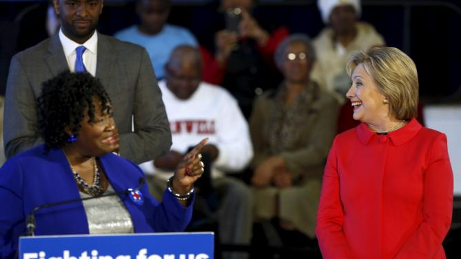 Bamberg County Schools Superintendent Thelma Sojourner (L) introduces Democratic U.S. presidential candidate Hillary Clinton (R) at a forum at Denmark-Olar Elementary School in Denmark, South Carolina February 12, 2016. REUTERS/Jonathan Ernst