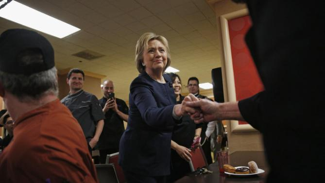 Democratic presidential candidate Hillary Clinton meets with employees of Harrah's Las Vegas, Saturday, Feb. 13, 2016, in Las Vegas. (AP Photo/John Locher)