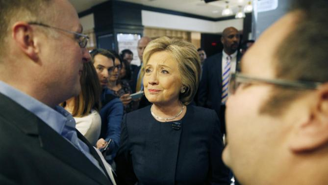 Democratic presidential candidate Hillary Clinton meets with patrons at Harrah's Las Vegas, Saturday, Feb. 13, 2016, in Las Vegas. (AP Photo/John Locher)