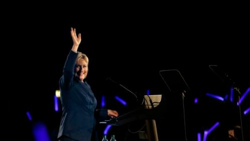 Democratic presidential candidate Hillary Clinton waves before speaking to guests at the Colorado Democrats 83rd Annual Dinner, in Denver, Saturday, Feb. 13, 2016. (AP Photo/Brennan Linsley)
