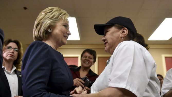 Democratic presidential candidate Hillary Clinton greets a worker at Harrah's Las Vegas in Las Vegas, Nevada February 13, 2016. REUTERS/David Becker