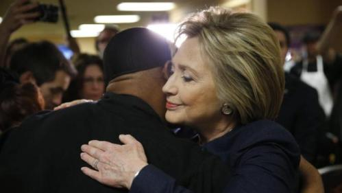 Democratic presidential candidate Hillary Clinton hugs an employee of Harrah's Las Vegas during a visit to the casino, Saturday, Feb. 13, 2016, in Las Vegas. (AP Photo/John Locher)