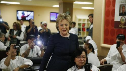 Democratic presidential candidate Hillary Clinton meets with employees of Harrah's Las Vegas during a visit to the casino, Saturday, Feb. 13, 2016, in Las Vegas. (AP Photo/John Locher)