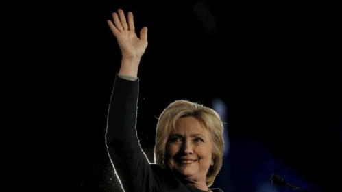 U.S. Democratic presidential candidate Hillary Clinton waves to the audience at the Jefferson-Jackson dinner in Denver, Colorado, United States, February 13, 2016.   REUTERS/Jim Young