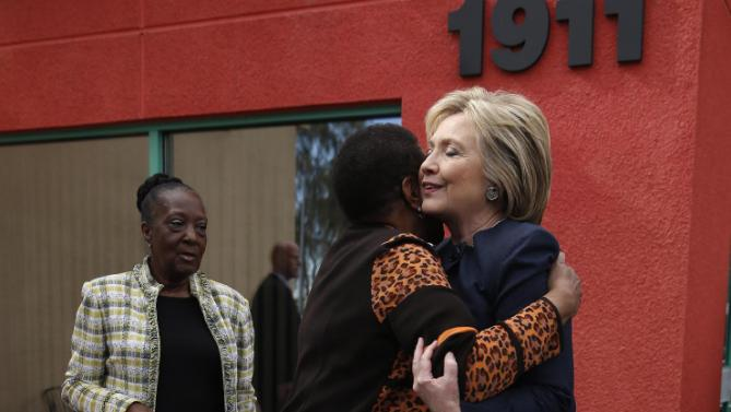 Democratic presidential candidate Hillary Clinton meets with people in front of a beauty school, Saturday, Feb. 13, 2016, in Las Vegas. (AP Photo/John Locher)