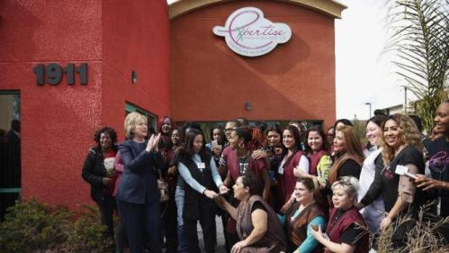 Democratic presidential candidate Hillary Clinton, second from left, poses for pictures with students of a beauty school, Saturday, Feb. 13, 2016, in Las Vegas. (AP Photo/John Locher)