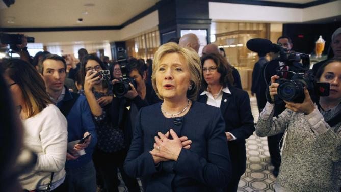 Democratic presidential candidate Hillary Clinton reacts to meeting a couple at Harrah's Las Vegas, Saturday, Feb. 13, 2016, in Las Vegas. (AP Photo/John Locher)