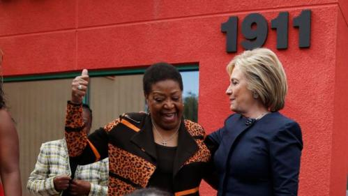 Democratic presidential candidate Hillary Clinton, top right, meets with people in front of a beauty school Saturday, Feb. 13, 2016, in Las Vegas. (AP Photo/John Locher)