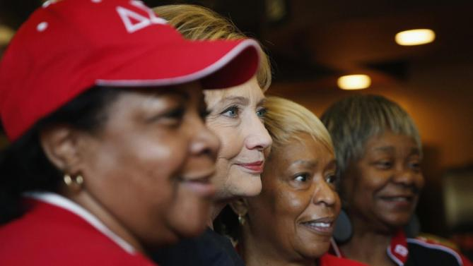 Democratic presidential candidate Hillary Clinton, second from left, poses for photos at the Gritz Cafe, Saturday, Feb. 13, 2016, in Las Vegas. (AP Photo/John Locher)