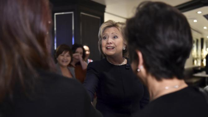Democratic presidential candidate Hillary Clinton greets people at Harrah's Las Vegas in Las Vegas, Nevada February 13, 2016. REUTERS/David Becker