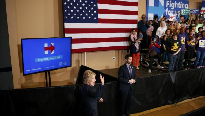 Democratic presidential candidate Hillary Clinton waves to the crowd as she takes the stage at a rally, Saturday, Feb. 13, 2016, in Henderson, Nev. (AP Photo/John Locher)