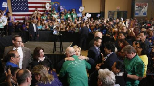 Democratic presidential candidate Hillary Clinton, center facing camera, hugs a supporter during a rally, Saturday, Feb. 13, 2016, in Henderson, Nev. (AP Photo/John Locher)