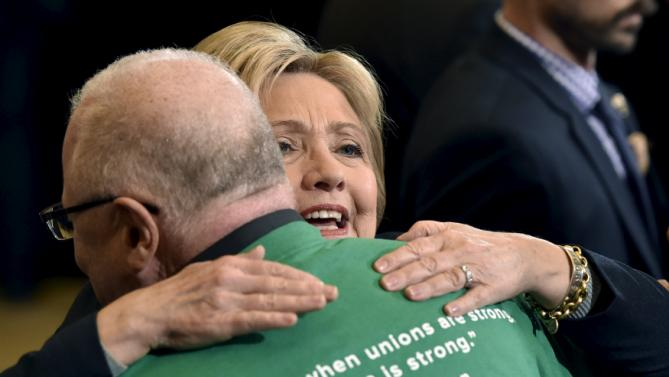 Democratic presidential candidate Hillary Clinton greets people after speaking at a campaign rally at the International Union of Painters and Allied Trades (IUPAT) training center in Henderson, Nevada February 13, 2016. REUTERS/David Becker