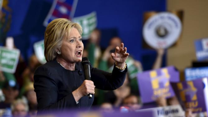 Democratic presidential candidate Hillary Clinton speaks during a campaign rally at the International Union of Painters and Allied Trades (IUPAT) training center in Henderson, Nevada February 13, 2016. REUTERS/David Becker
