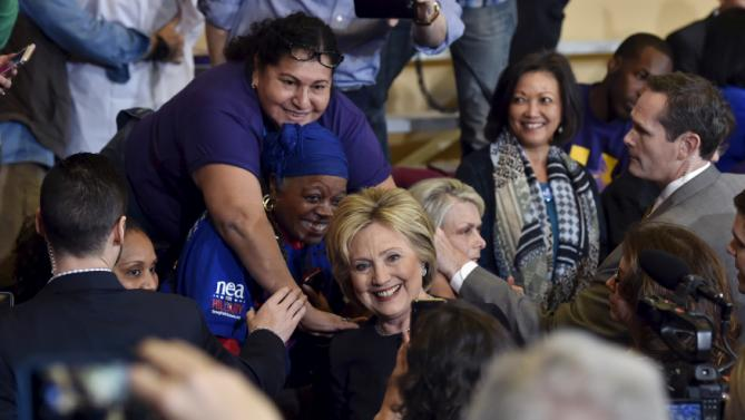 U.S. Secret Service personal stops a woman from touching Democratic presidential candidate Hillary Clinton as she greets people after speaking at a campaign rally at the International Union of Painters and Allied Trades (IUPAT) training center in Henderson, Nevada, February 13, 2016. REUTERS/David Becker