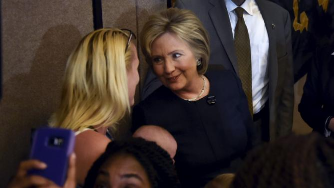 Democratic presidential candidate Hillary Clinton greets a supporter after speaking at a campaign rally at the International Union of Painters and Allied Trades (IUPAT) training center in Henderson, Nevada February 13, 2016. REUTERS/David Becker