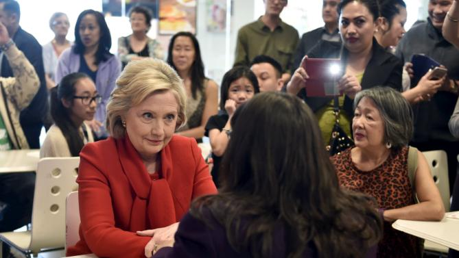 Democratic presidential candidate Hillary Clinton speaks Nevada Assembly woman Irene Bustamante-Adams at a sandwich shop in Las Vegas, Nevada February 14, 2016. REUTERS/David Becker