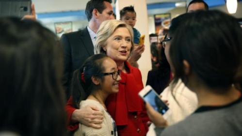 Democratic presidential candidate Hillary Clinton visits Lee's Sandwiches during a campaign stop Sunday, Feb. 14, 2016, in Las Vegas. (AP Photo/John Locher)