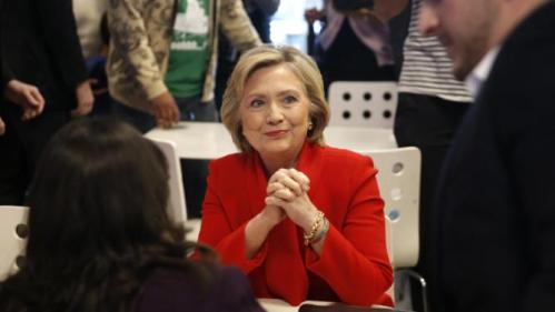 Democratic presidential candidate Hillary Clinton, center, visits Lee's Sandwiches during a campaign stop Sunday, Feb. 14, 2016, in Las Vegas. (AP Photo/John Locher)