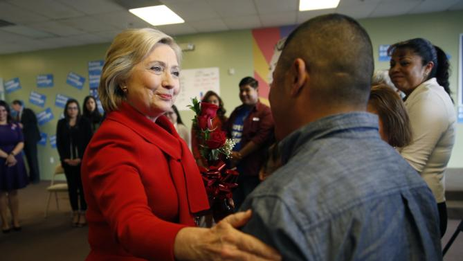 "Democratic presidential candidate Hillary Clinton, left, meets with people at an event to speak with young immigrants, or so-called ""dreamers"" and their families at a campaign office Sunday, Feb. 14, 2016, in Las Vegas.  (AP Photo/John Locher)"