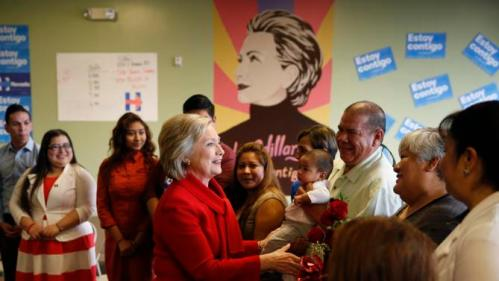 "Democratic presidential candidate Hillary Clinton, in red, speaks at an event to meet with young immigrants, or so-called ""dreamers,"" and their families at a campaign office Sunday, Feb. 14, 2016, in Las Vegas. (AP Photo/John Locher)"