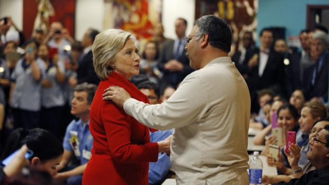 Democratic presidential candidate Hillary Clinton speaks with an employee of Caesars Palace during a visit to the casino Sunday, Feb. 14, 2016, in Las Vegas. (AP Photo/John Locher)