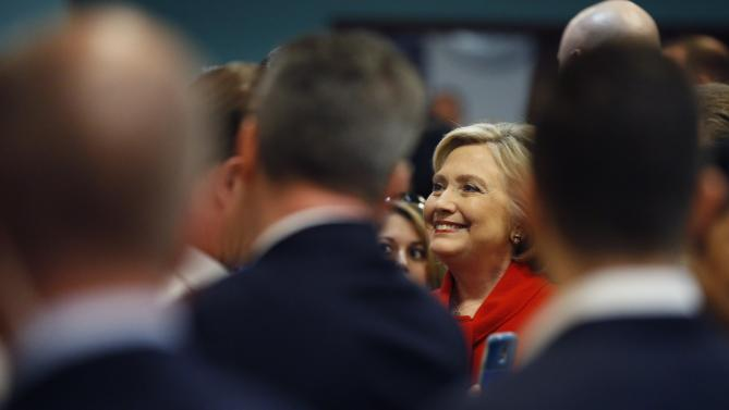 Democratic presidential candidate Hillary Clinton meets with employees of Caesars Palace during a visit to the casino Sunday, Feb. 14, 2016, in Las Vegas. (AP Photo/John Locher)