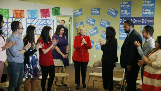 "Democratic presidential candidate Hillary Clinton, center, arrives at an event to meet with young immigrants, or ""dreamers,"" at a campaign office Sunday, Feb. 14, 2016, in Las Vegas.  (AP Photo/John Locher)"