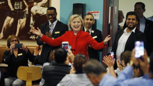 Democratic presidential candidate Hillary Clinton speaks with employees of Caesars Palace during a visit to the casino Sunday, Feb. 14, 2016, in Las Vegas. (AP Photo/John Locher)