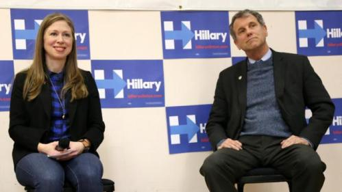 Chelsea Clinton, left, sits alongside U.S. Sen. Sherrod Brown, D-Ohio, as she speaks at the Murtis H. Taylor Community Center, Monday, Feb. 15, 2016, in Cleveland. Clinton made a campaign stop for her mother, Democratic presidential candidate Hillary Clinton, to talk with voters. (AP Photo/Aaron Josefczyk)