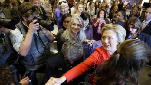 Democratic presidential candidate Hillary Clinton, right, shakes hands with supporters after participating in a women's health discussion at the University of Nevada on Monday, Feb. 15, 2016, in Reno, Nev. (AP Photo/Marcio Jose Sanchez)