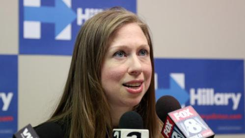 Chelsea Clinton talks to reporters after speaking at the Murtis H. Taylor Community Center, Monday, Feb. 15, 2016, in Cleveland. Clinton made a campaign stop for her mother, Democratic presidential candidate Hillary Clinton, to talk with voters. (AP Photo/Aaron Josefczyk)