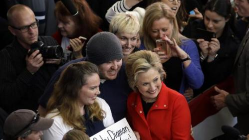 Democratic presidential candidate Hillary Clinton, in red, poses for photos with supporters after speaking at a rally at Truckee Meadows Community College on Monday, Feb. 15, 2016, in Reno, Nev. (AP Photo/Marcio Jose Sanchez)