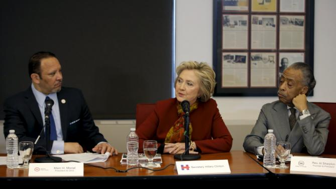 Democratic U.S. presidential candidate Hillary Clinton makes remarks as she meets with civil rights leaders at the National Urban League in the Manhattan borough of New York City, February 16, 2016. At left is Marc H. Morial, President and CEO, National Urban League and at right is The Reverend Al Sharpton, Founder and President, National Action Network.  REUTERS/Mike Segar