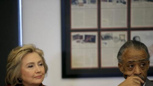 Democratic U.S. presidential candidate Hillary Clinton (L) sits with The Reverend Al Sharpton, Founder and President of the National Action Network, as she meets with civil rights leaders at the National Urban League in the Manhattan borough of New York City, February 16, 2016.  REUTERS/Mike Segar