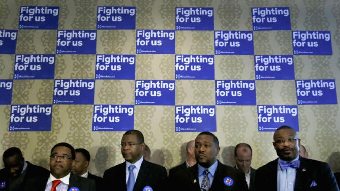 Local leaders await the arrival of Democratic presidential candidate Hillary Clinton for a campaign stop, Wednesday, Feb. 17, 2016, in Chicago. (AP Photo/Charles Rex Arbogast)