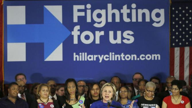 Mothers and sisters who have lost a family member to violence, stand behind Democratic presidential candidate Hillary Clinton during a campaign stop, Wednesday, Feb. 17, 2016, in Chicago. (AP Photo/Charles Rex Arbogast)